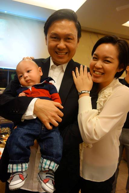 Warren Tan and his wife and baby