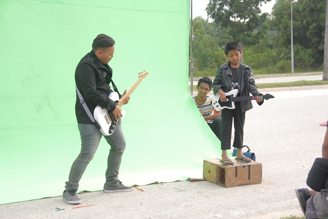 he musical band of the film soundtrack in front of a green screen on Putrajaya highway