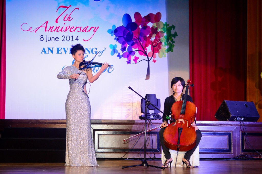 Dr Joanne Yeoh (left) performing onstage with her sister