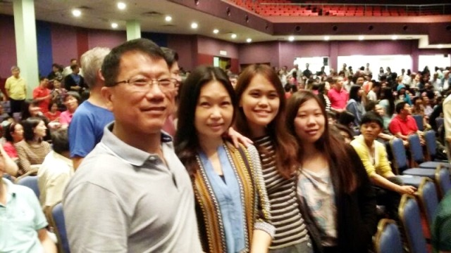 Liew Ah Onn (most left) with his wife and daughters