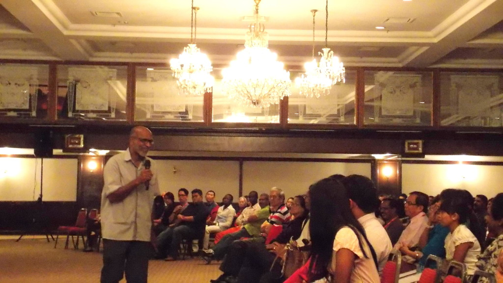 Rev Benedict Rajan preaching to the crowd during the Miracle Breakthrough Rally