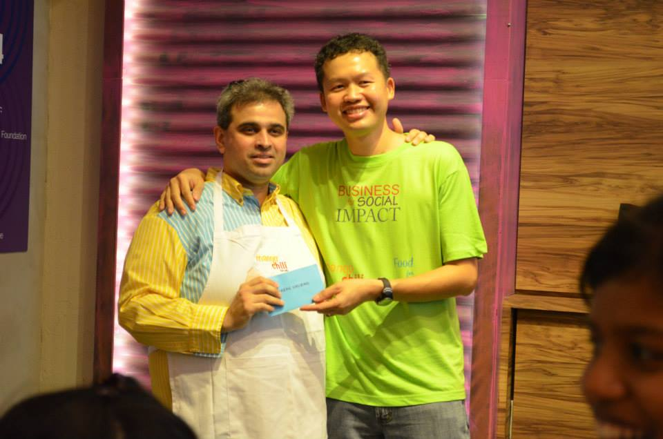 Ronald or amicably known as Ron (right) giving a token of appreciation to Sharan Valiram for gracing the official launch of Mango Chili