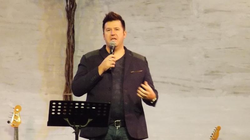 Pr Derek Dunn preaching the Word