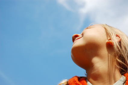 little girl looking up in the sky