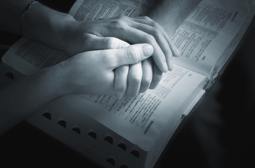 holding-hands-over-bible-by-vibe-images