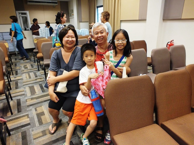 A joyful family who brought their children to join the Shuffle Champ Spelling Competition