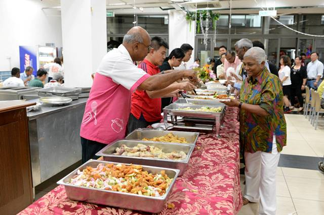 The guests enjoying a scrumptious dinner by CARE