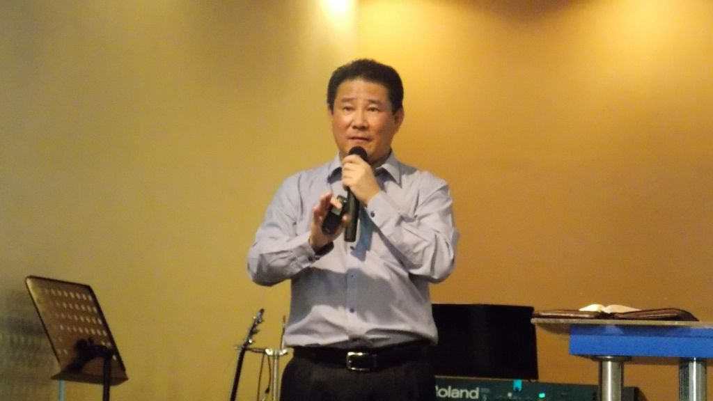 Brother Vincent Leong preaching the Word