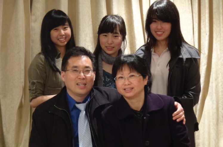 Tony Tay (Front row, left) and his family