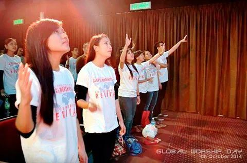 The young adults and youths worshiping God at Bible College Malaysia