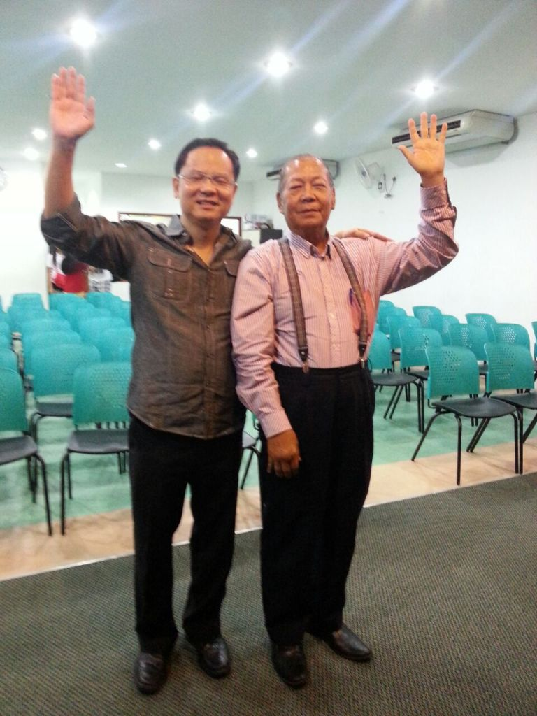 Eddy Yong (left) with a brother-in-Christ who was full in faith