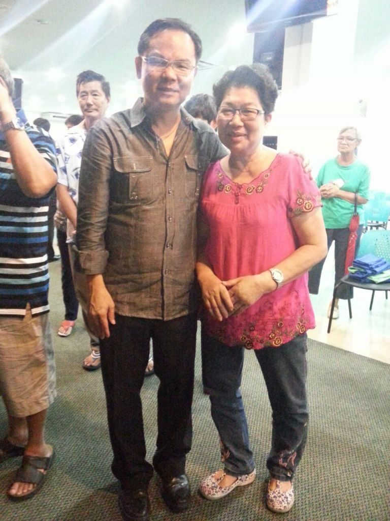 Eddy Yong (left) with an attendee of the FGA Healing Service