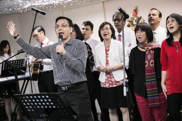 Bryan Gan, emcee of the Christmas party of Menara TA One (front)