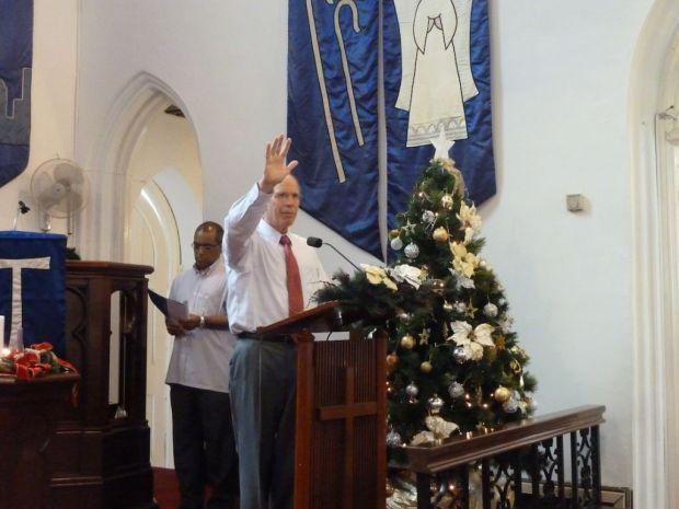 Rev Robert Weniger praying for the congregation