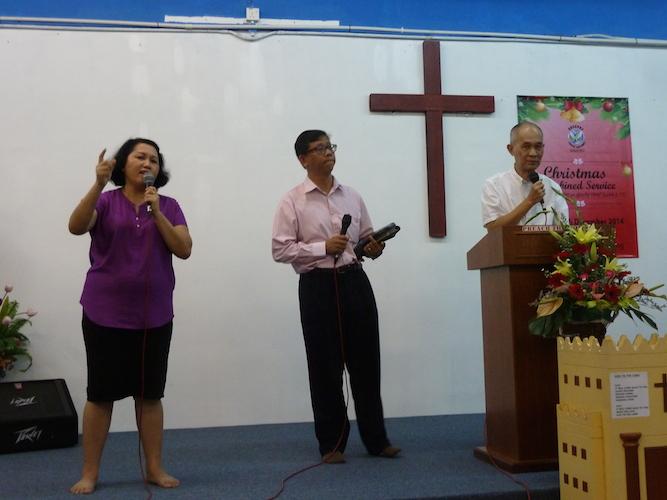 Pastor Tan Jooi Long (most right) with translators to translate the sermon in Bahasa Melayu and Mandarin