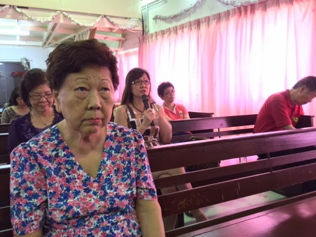 A church attendee sharing her significant point in life