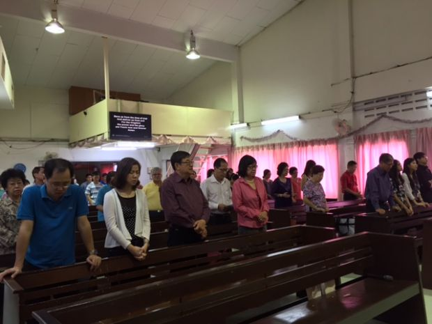 The congregation rising in prayer