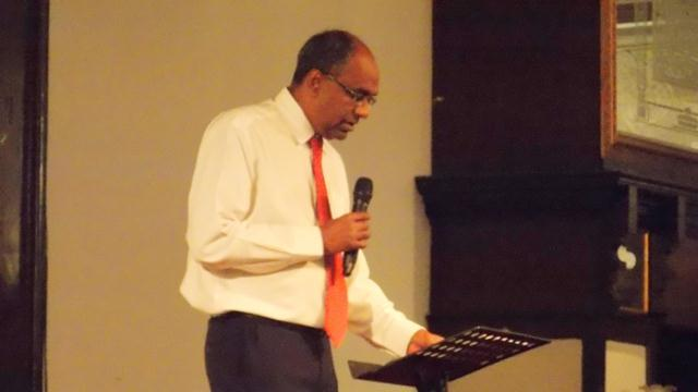 Pastor Suresh preaching the Word