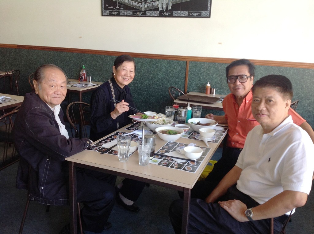 HT Long (Right, back) with Goldie (Left, back) and her husband Tek Chong (Left, front)