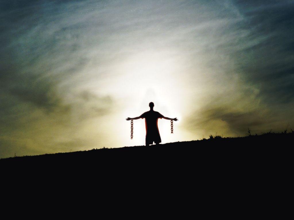 Silhouette Standing Chains Broken Freedom From Slavery (amysorrells.files.wordpress.com+2009+10+silhouette20standing20chains20broken20freedom20from20slavery.jpg)