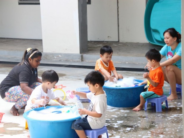 Children enjoying some time outside with water activities