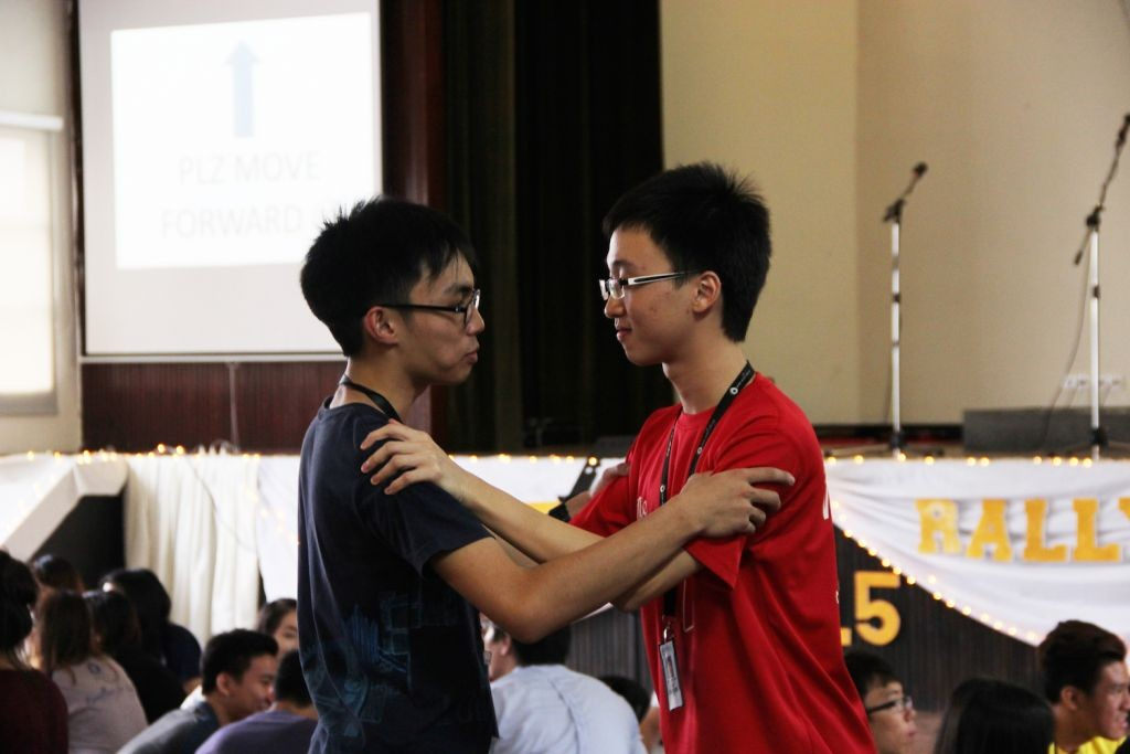 Two MCKL students greeting each other before the rally started