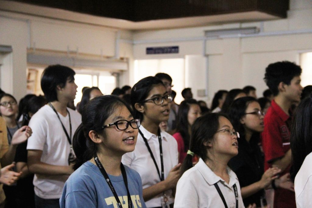 Students lifting their voices together in worship