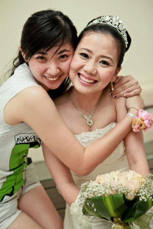 Irene Lee (left) embracing her good friend