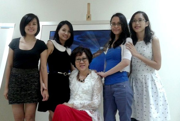 """Dr Peggy (middle) with her group of mentees, also called the """"Power Angels."""""""