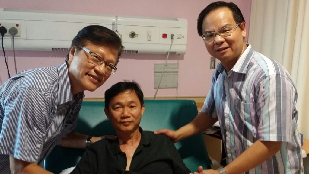 Eddy Yong (right) and a patient he prayed for Jesus to heal