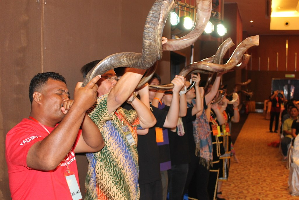 Helpers of the AMRC blowing the shofar in inaugurating the event
