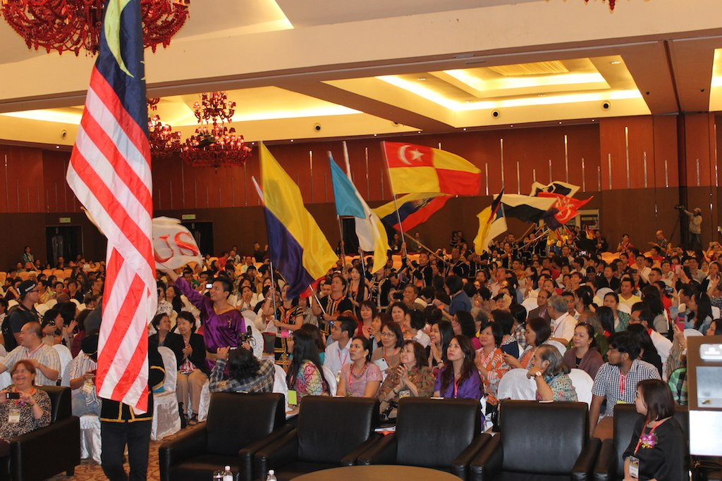 The people carrying flags resembling the covering of God over all states in Malaysia because God loves Malaysia