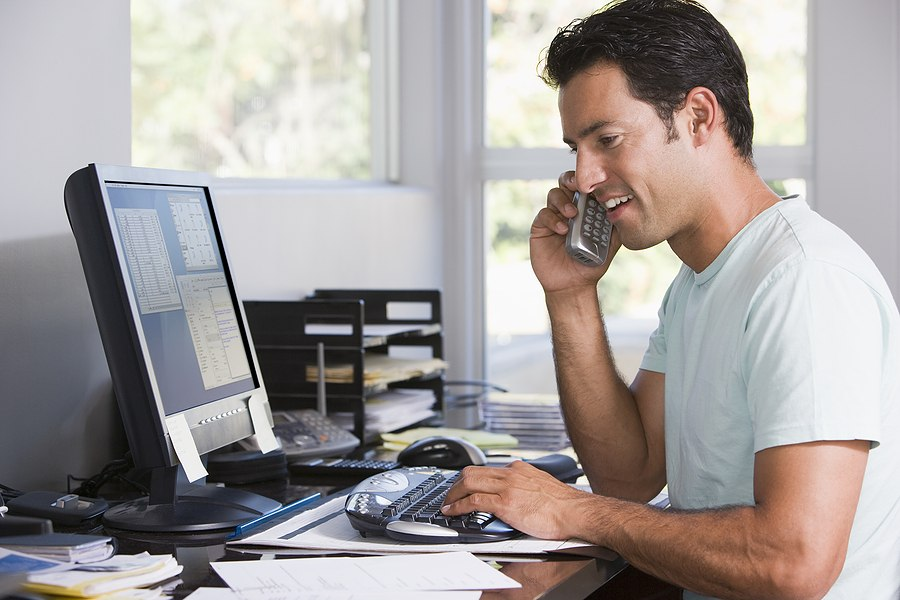 bigstock-Man-In-Home-Office-On-Telephon-4133311