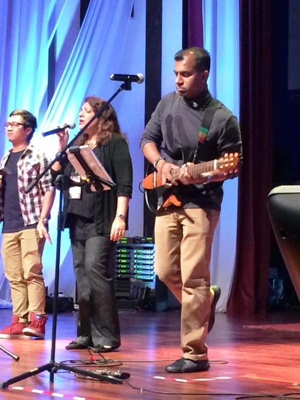 Shamini Ruth (middle) singing with the Global Worship Team of Malaysia at 3 AM
