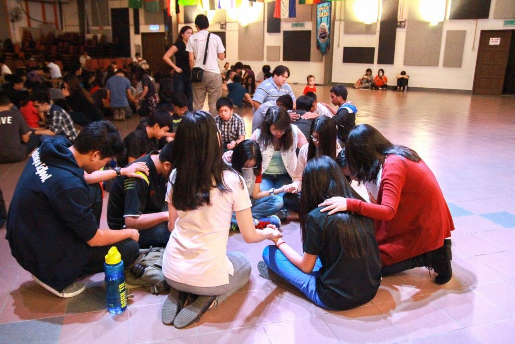 Praying over the youth  Photo Credit: Naaman Foong