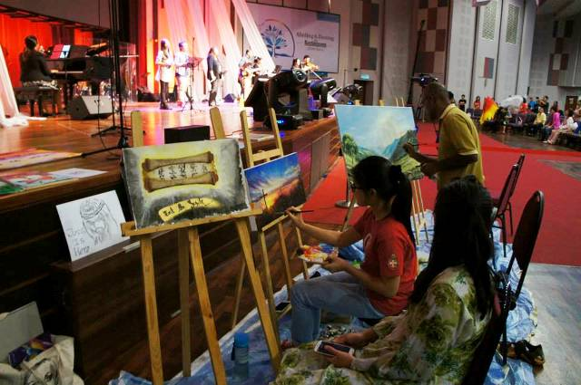 Worshippers painting to God, inspired by His Spirit