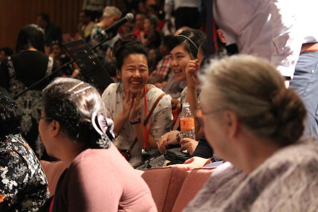 Joyful attendees of the healing crusade