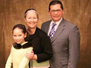 Rev Eli Hernandez (right) and his family