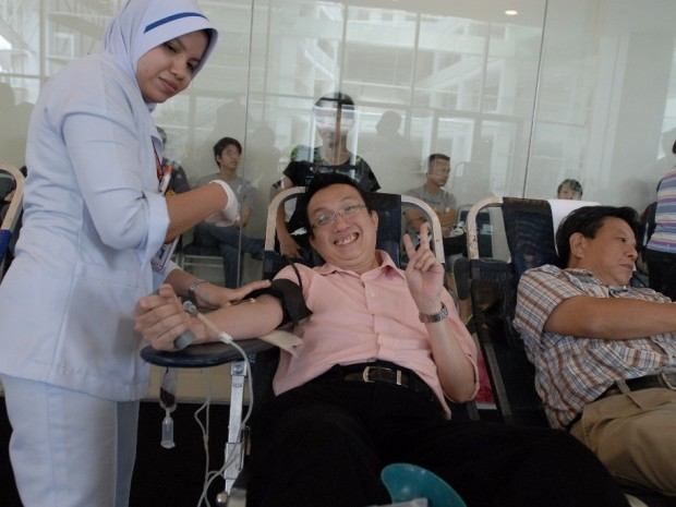 A donor giving the thumbs up after donating blood!