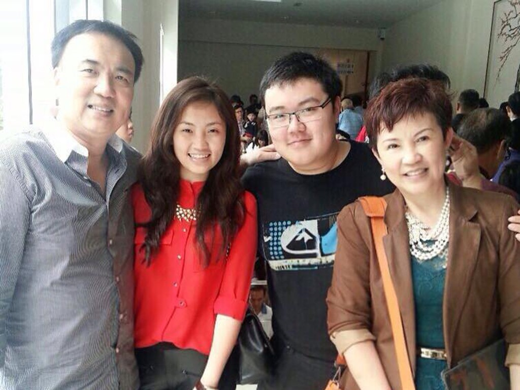 Aaron with his parents and sister