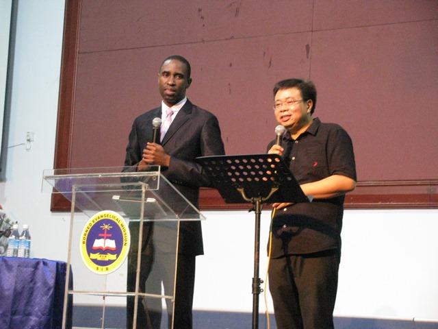 Apostle Suubi with translator Pastor Hii