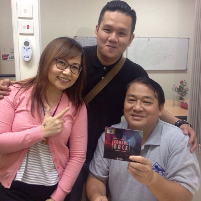 Ricky Sutanto (middle) with Pastor Kenny Tham and his wife