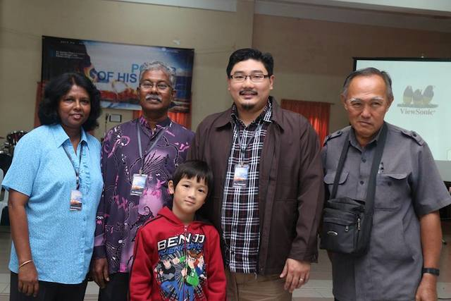 Gnanam (first from left) and Pastor Moses (second from left) with Damien Chua (second from right) and a brother-in-Christ