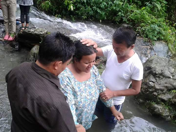 Yohang Sunbba's mother getting baptized.