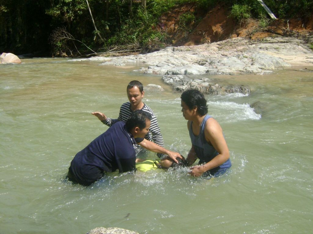 Pastor Nick baptizing his church members