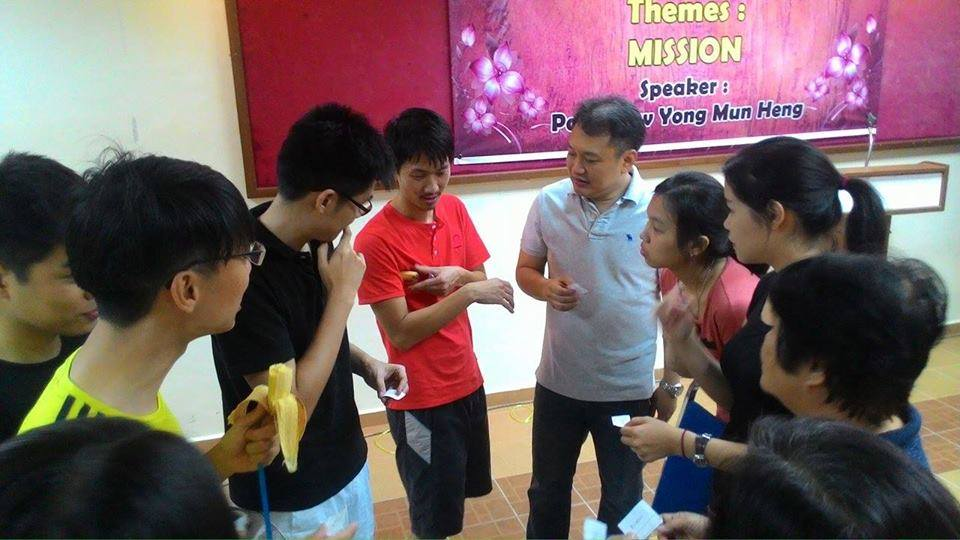 Pastor Jacob Yeng (4th from right) with his church family in a game session of AJPC Family Camp on October 2015