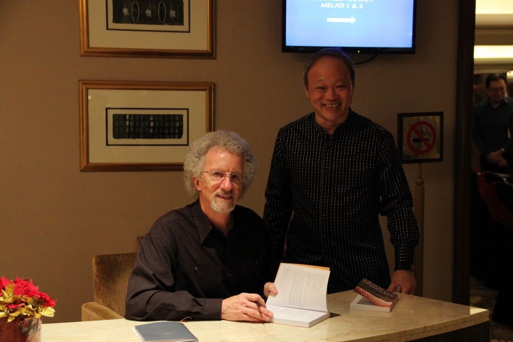Dr. Yancey signing books for the church leaders