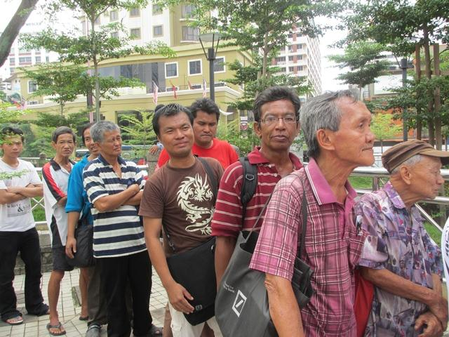 The street people lining up for food in the H. O. P. E. ministry founded by Veron for the street people