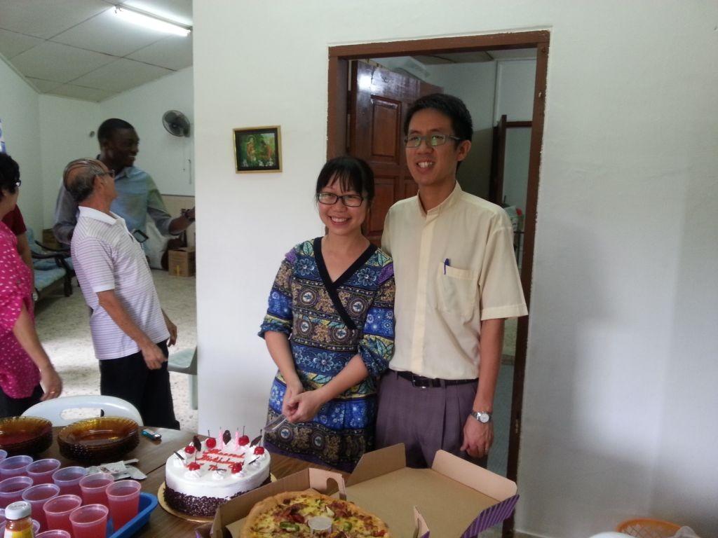 Pastor Simon celebrating his wife Pei Ting's birthday in the Saint Martin's Anglican church in Kota Bharu