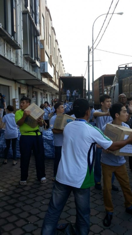 The 72 volunteers from World Vision and CREST, helping to unload the truck of supplies to the warehouse